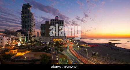 Israel, Tel Aviv, elevated dusk view of the city beachfront - Stock Photo