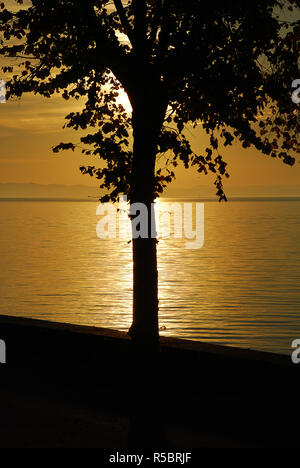 Lindau, Germany: A view of the Bodensee (aka Lake Constance), in the distance Austria, and Switzerland, at sunset in the summer - Stock Photo