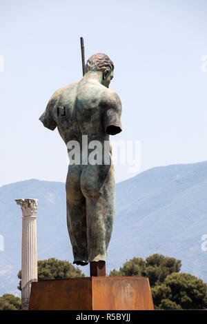 Pompeii, Italy - June 15, 2017: Sculptures of the Polish sculptor Igor Mitoraj on display at Pompeii archaeological site, the ancient Roman city, dest - Stock Photo