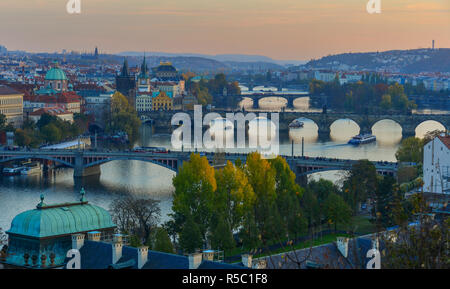 Bridges of Prague over Vltava River on sunny day. Scenic view from Letna Hill in Prague, Czech Republic. Stock Photo