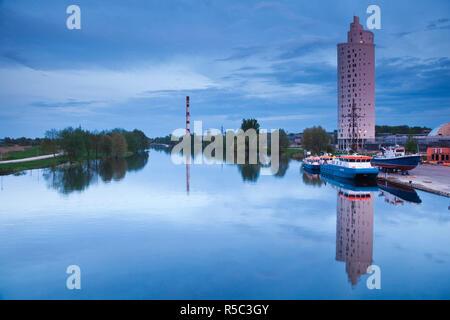 Estonia, Southeastern Estonia, Tartu, highrise building by Emajogi River, dusk - Stock Photo