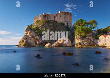 Fort Lovrijenac in Dubrovnic as seen from the beach.  Long exposure to create flat water on a clear bright sunny day. - Stock Photo