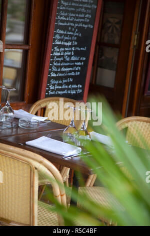 Table outside cafe/restaurant, Paris, France - Stock Photo