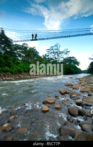 Costa Rica, La Virgen de Sarapiqui, Suspension Bridge, Sarapiqui River, White Water Rafting, Guide And Tourists, Tirimbina Biological Reserve - Stock Photo