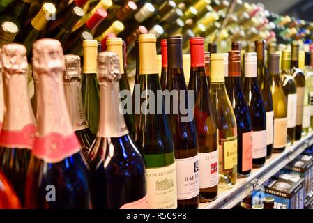Assorted, colorful and diverse selection of Sonoma and Napa County bottled wines on shelf display at a Oakville Grocery, Healdsburg, California, USA - Stock Photo