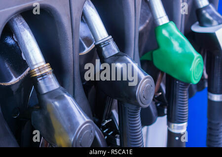 Close up of gas pump nozzles in a service station - Stock Photo