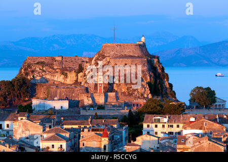 Aerial view from New fortress on the city with Old fortress before sunset, Kerkyra, Corfu island, Greece - Stock Photo