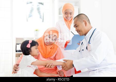 Child with broken arm - Stock Photo