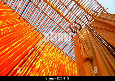 Newly dyed fabric being hung up to dry, Sari garment factory, Rajasthan, India, (MR/PR) - Stock Photo