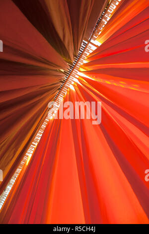 Newly dyed fabric hanging from Bamboo poles to dry, Sari garment factory, Rajasthan, India, (PR) - Stock Photo