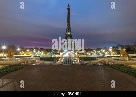 Very early morning sunrise on the Eiffel tower not lit at all, view from the Trocadero fountain water in Paris, one of the most visited building by th - Stock Photo