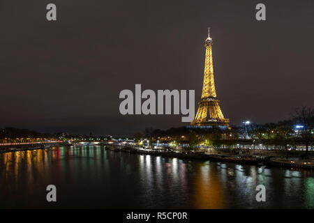 PARIS, 28 November 2018 - Illuminated Eiffel tower reflection on the Trocadero fountain water in Paris, one of the most visited building by the touris - Stock Photo