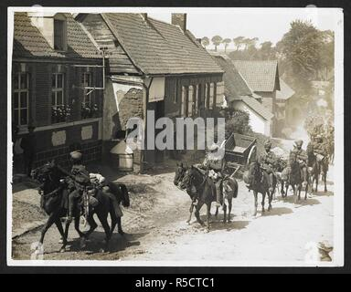Indian cavalry marching through a French village [near Fenges]. Troop of 36th Jacob's Horse riding through a village. 1 August 1915. Record of the Indian Army in Europe during the First World War. 20th century, 1915. Gelatin silver prints. Source: Photo 24/(212). Author: Girdwood, H. D. - Stock Photo