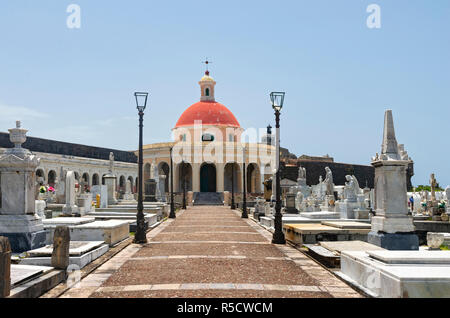 walkway leading to chapel and past gravesites in landmark cemetery santa maria magdalena de pazzis in old san juan puerto rico - Stock Photo