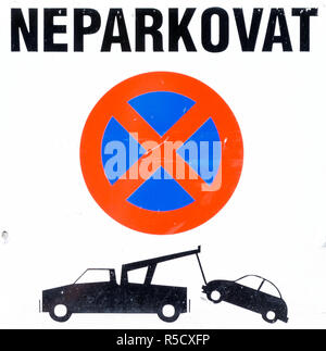 Czechian No Parking sign, cutout, showing a car being towed by a truck - Stock Photo