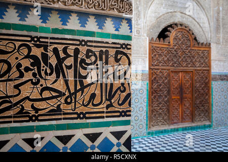The beautifully ornate interior of Madersa Bou Inania, Fes, Morocco - Stock Photo