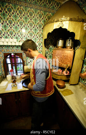 Waiter preparing Turkish Coffees in the kitchen of Pierre Loti Cafe, Eyup, Istanbul, Turkey - Stock Photo