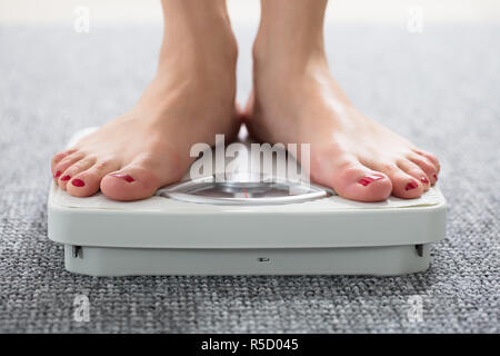 Woman's Feet On Scale - Stock Photo