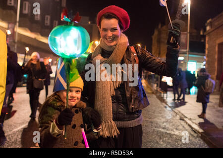 Glasgow, Scotland, UK - 30 November 2018: Glasgow's third torchlight St Andrew's Day Parade part of the West End Festival started in the dry at Glasgow's Botanic Gardens.   A  later very heavy shower may have extinguished a few torches but didn't dampen spirits as the parade  made it's way through Glasgow's West End to Kelvingrove Art Gallery and Museum - Stock Photo