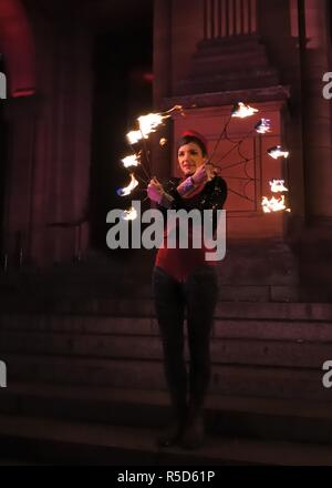 30th, November, 2018. Glasgow, Scotland, UK, Europe. West End Festival. A fire spinner at the St Andrew's Day Torchlight Parade as part of Event Scotland's Winter events programme. - Stock Photo