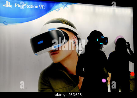 November 30, 2018 - L´Hospitalet, Barcelona, Spain - A young girl seen getting ready to play with virtual reality glasses with a Play Station coach during the Barcelona Fair Games World.First day of the Barcelona Games World fair, it's dedicated to the video game industry and presents its main exhibition in Barcelona between November 29 and December 2. Credit: Ramon Costa/SOPA Images/ZUMA Wire/Alamy Live News - Stock Photo