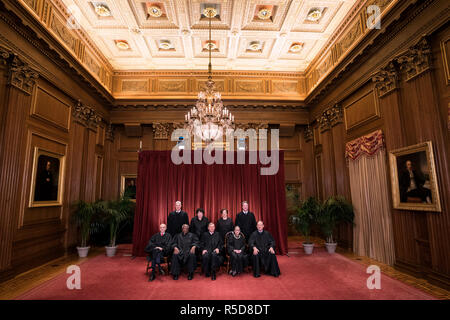 The Supreme Court Justices pose for their official group portrait in the Supreme Court on November 30, 2018 in Washington, DC Seated from left: Associate Justice Stephen Breyer, Associate Justice Clarence Thomas, Chief Justice John G. Roberts, Associate Justice Ruth Bader Ginsburg and Associate Justice Samuel Alito, Jr. Standing behind from left: Associate Justice Neil Gorsuch, Associate Justice Sonia Sotomayor, Associate Justice Elena Kagan and Associate Justice Brett M. Kavanaugh. Credit: Kevin Dietsch/Pool via CNP | usage worldwide - Stock Photo
