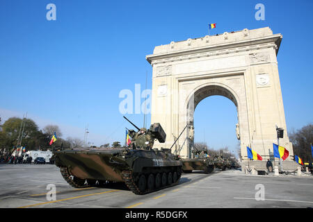 Bucharest, Romania. 1st December 2018. Romanian soldiers participate in a military parade to celebrate the Centennial National Day in Bucharest, Romania, Dec. 1, 2018. Romania held on Saturday a grand military parade to celebrate the Centennial National Day, with over 4,000 Romanian and foreign servicemen to march under the Arch of Triumph in northern Bucharest. Credit: Gabriel Petrescu/Xinhua/Alamy Live News - Stock Photo