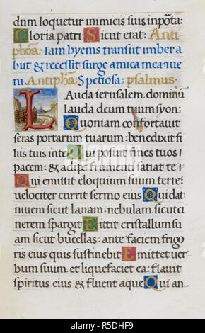Text page with initial 'L'. Mirandola Hours. Italy, circa 1490-1499. [Whole folio] Text page from the Hours of the Virgin. The end of Psalm 126; Psalm 147 with initial 'L', formed of branches against a scenic background Image taken from Mirandola Hours. Originally published/produced in Italy, circa 1490-1499. Source: Add. 50002, f.43. Language: Latin. - Stock Photo