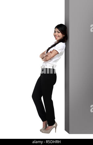 Asian business woman lean on the block - Stock Photo