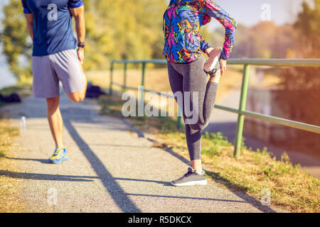 Young Sports woman and man getting ready to run and exercise outdoors