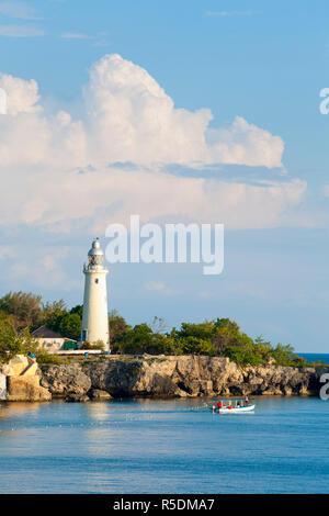 Rugged coastline &  Lighthouse, West End, Negril, Westmoreland Parish, Jamaica, Caribbean - Stock Photo