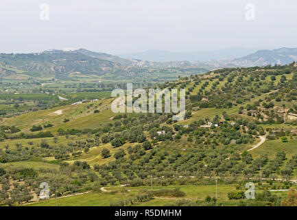 View towards the west and the town of Pisticci  from the castle wall  in the hilltop town of Bernalda in Basilicata, Southern Italy - Stock Photo