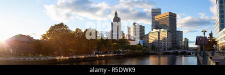 Panoramic view of a beautiful modern city during a vibrant sunset. Taken in Downtown Providence, Rhode Island, United States. - Stock Photo