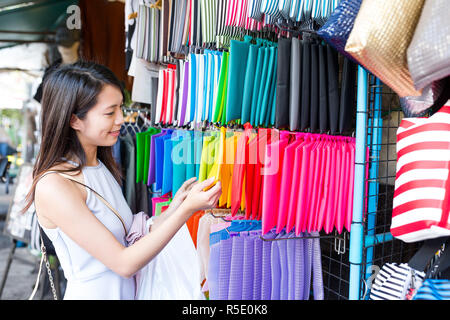 Woman shopping in street market - Stock Photo