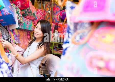 Woman shopping in the weekend market - Stock Photo