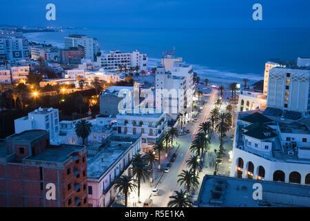 Tunisia, Tunisian Central Coast, Sousse, elevated view of Avenue Habib Bourguiba towards Boujaffar Beach, dusk - Stock Photo