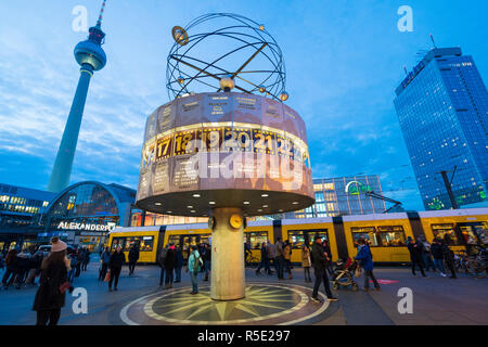 Evening view of World Clock and Television Tower, or Fernsehturm, at Alexanderplatz , Mitte, in Berlin , Germany - Stock Photo