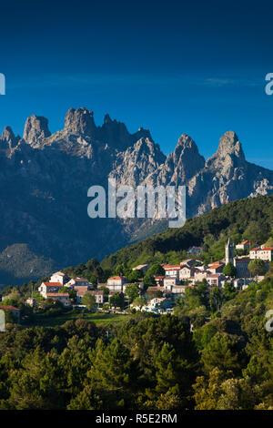 France, Corsica, Corse-du-Sud Department, La Alta Rocca Region, Zonza, elevated town view with the Aiguilles de Bavella peaks - Stock Photo