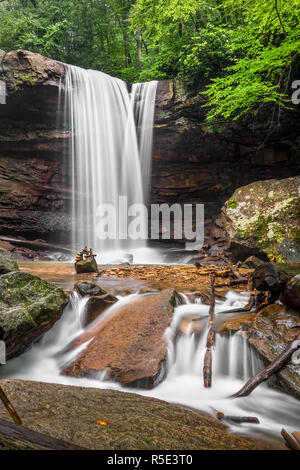 As viewed from downstream on a misty day, Cucumber Falls plunges over a cliff on its way to the nearby Youghiogheny River in the Laurel Highlands of P - Stock Photo