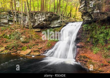 Sullivan Falls, a beautiful Pennsylvania waterfall, splashes down a cliff in an autumn landscape. - Stock Photo