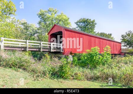 Built in 1863, Red Bridge, a covered bridge near Princeton, Illinois, spans Big Bureau Creek. - Stock Photo