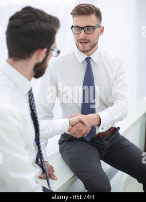 close up.welcome handshake of the company's employees - Stock Photo