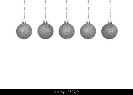 A silver Christmas bauble hanging on a white ribbon, isolated on a white background with a clipping path and copy space, christmas decorations. - Stock Photo