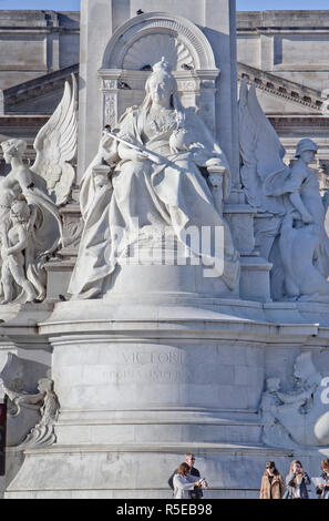Victoria Memorial. The immense marble statue  of Queen Victoria, by Thomas Brock, is located in front of Buckingham Palace in The Mall, London, UK. - Stock Photo