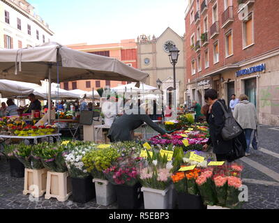 TIVOLI, ITALY - SEPTEMBER 29, 2017: Fresh and beautiful flowers, fruits and vegetables at the farmer market in the main square Piazza Plebiscito of Ti