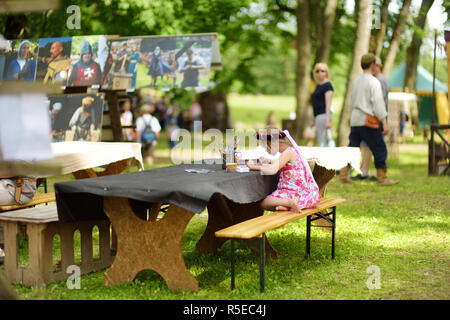 TRAKAI, LITHUANIA - JUNE 16, 2018: Children having fun during annual Medieval Festival, held in Trakai Peninsular Castle. Recreating medieval town spi - Stock Photo