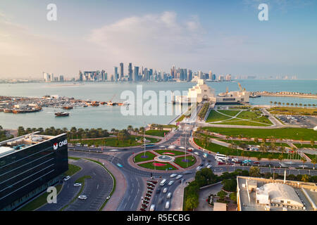 Qatar, Doha, Elevated view over the Museum of Islamic Art and the Dhow harbour to the modern skyscrapper skyline - Stock Photo