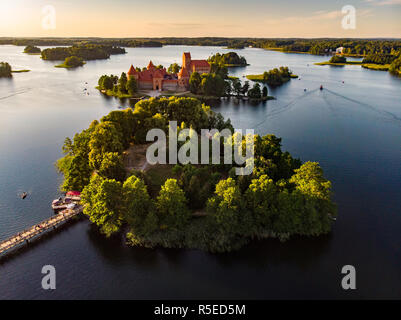 Aerial view of Trakai Island Castle, located in Trakai, Lithuania. Beautiful view from the above on summer sunset. - Stock Photo