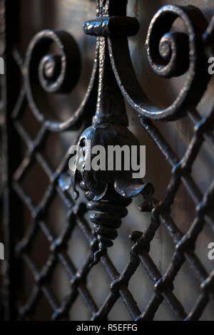 A fragment of a decorative lattice on the old door. The fragment of forged metal products. Close-up. - Stock Photo