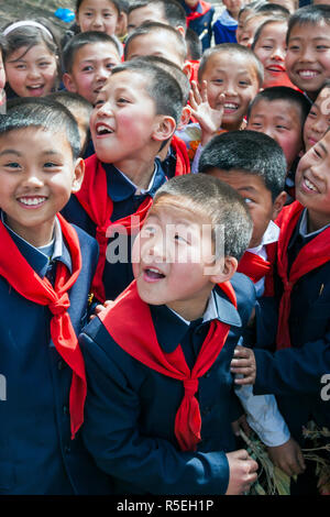 Democratic Peoples's Republic of Korea (DPRK), North Korea, Pyongyang, schoolchildren during street celebrations on the 100th anniversay of the birth of President Kim IL Sung, April 15th 2012 - Stock Photo
